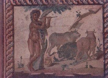 Corinthia ,south of Athens, Greece painted in the wall of a ruin this picture strongly resembles the Cow tending flute playing Lord Krishna.